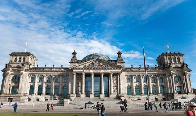 The Reichstag, a historic building that looks like a classical temple, is the seat of the German parliament.